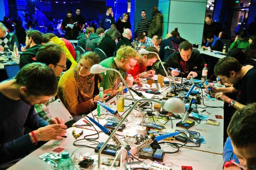 Room full of happy hardware hackers at the Hardware Hacking Area at 30C3